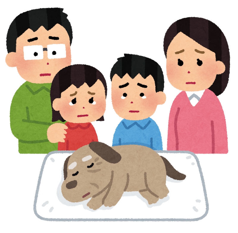 老犬を看取って泣いている家族