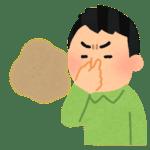 鼻をつまんで臭そうにしている男性
